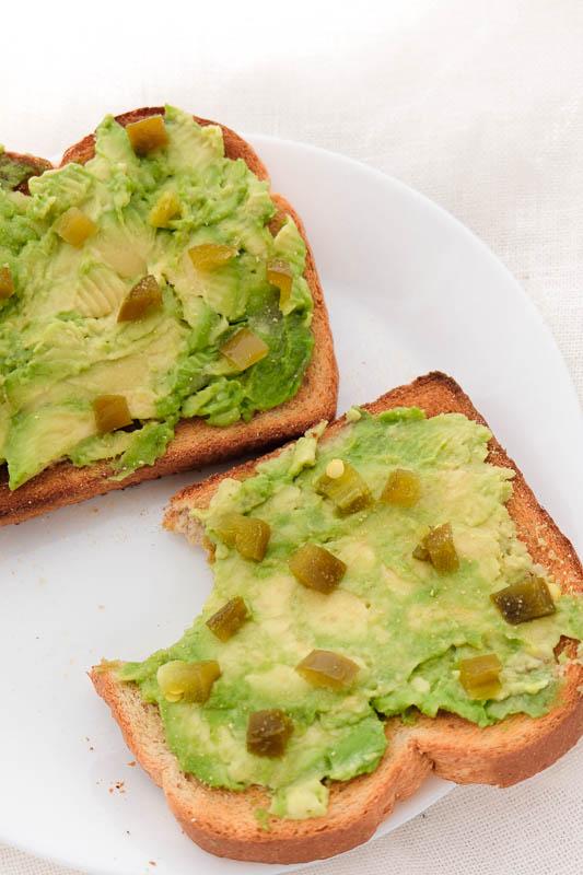 avocado toast topped with jalapeno and garlic powder.