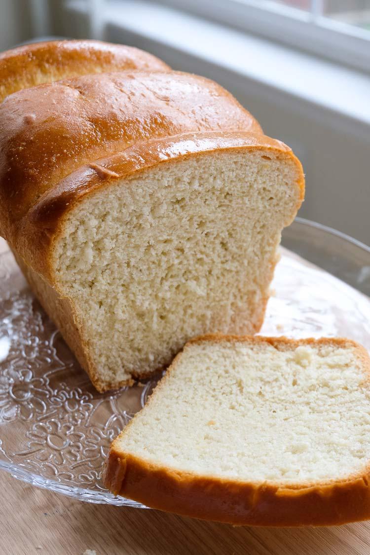 The best vegan brioche bread sliced on a plate.