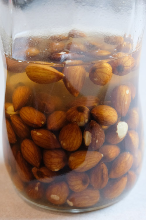 Almonds being soaked in a jar.