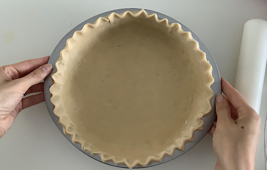 An uncooked pie crust formed into a pan.